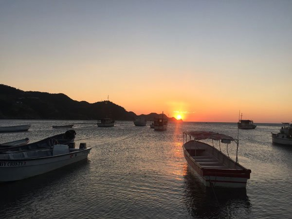 taganga bay sunset view boats ocean red sky